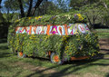 Bus covered with pansies of many colors Royalty Free Stock Photo