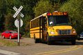 Bus at crossing a school stopped a uncontrolled railroad in roseburg oregon Royalty Free Stock Image