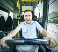 Bus driver with scared face at the wheel panic Stock Photo