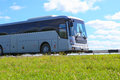 Bus goes on the country highway silvery Royalty Free Stock Photos