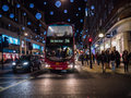 Bus on oxford street surrounded by shopping crowds christmas week london england baker station at night during stroll sidewalks Royalty Free Stock Photos