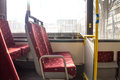 Bus seats interior of empty public transport with red Royalty Free Stock Photo