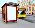 The bus stop on the city street with an empty billboard in an end face against yellow approached it Royalty Free Stock Image