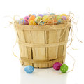 Bushel basket full of easter a filled with straw and colorful eggs on a white background Stock Photography