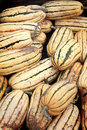 Bushel box of delicata squash a closeup view a fresh just picked loafshaped shallow depth field Royalty Free Stock Photos