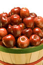 Bushel of red apples basket full shiny delicious Stock Photos