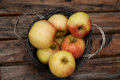 Bushel of red apples a in a rustic wooden basket Stock Images