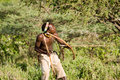 Bushman hadzabe lake eyasi tanzania february an unidentified hazabe with bow and arrow during hunting on february in tanzania Stock Images