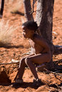 Bushman san boy while watching in a hunting day in namibia Royalty Free Stock Photography