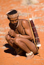 Bushman of san tribe demostrating how to hunt in the desert Royalty Free Stock Image