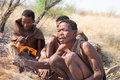 Bushmen kalahari botswana october group of have kindle a fire on october in desert of Stock Photography