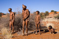 Bushmen sun family san demostration how to start a hunting in the early morning in the kalahari desert of namibia Stock Photo