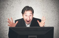 Busines man screaming at the computer, emotion, expression Royalty Free Stock Photo