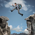 Business adversity businessman leap of faith concept for risk or challenge Royalty Free Stock Photos