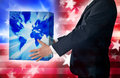 Business america a man in a suit holding a box with a world map and abstract american flag background Stock Photography