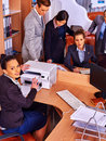 Business as usual. Happy group people printing out in office. Royalty Free Stock Photo