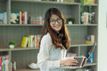 Business Asian girl using a laptop in library in office, person Royalty Free Stock Photo