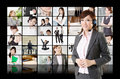 Business assistant stand front tv screen wall has many pictures business concept people Royalty Free Stock Photography
