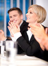 Business associates applauding corporate team sitting in a row and Royalty Free Stock Photos