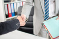 Business associates shaking hands at office Royalty Free Stock Image