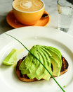 Business breakfast avocado toast coffee and water Royalty Free Stock Photography
