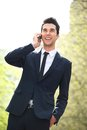 Business call portrait of a handsome businessman calling on phone Stock Photos