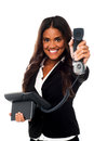 Business call for you boss smiling female assistant handing over the telephone receiver to her Royalty Free Stock Photo