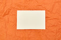 Business card on orange background. Mockup template