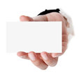 Business card in woman hand on white Royalty Free Stock Images