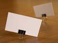 Business cards with paperclip fastener on a desk defocus composition Stock Image
