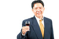 Business celebration businessman with glass of wine selective focus at glass Stock Photography