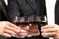 Business celebration close up of human hands cheering up with flutes of wine Stock Photos