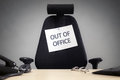 Business chair with out of office sign Royalty Free Stock Photo