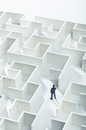 Business challenge a businessman navigating through a maze top view Royalty Free Stock Photography