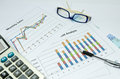 Business charts and graph with glasses eye and pen Royalty Free Stock Photo