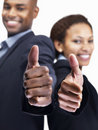 Business colleagues gesturing thumbs up sign Royalty Free Stock Images