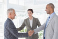 Business colleagues greeting each other in the office Royalty Free Stock Photography