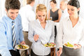 Business colleagues serve themselves at buffet Stock Photo