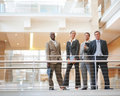 Business colleagues standing by a railing Royalty Free Stock Photos