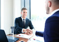 Business colleagues two shaking hands during meeting Royalty Free Stock Image