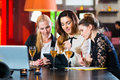 Business colleagues working with documents in a cafe young women or or restaurant they together and having fun they are good team Stock Images