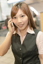 Business commute portrait of young woman stand and talk on mobile phone in the mrt station taipei taiwan asia Royalty Free Stock Images