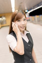 Business commute portrait of young woman stand and talk on mobile phone in the mrt station taipei taiwan asia Stock Image