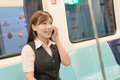 Business commute portrait of young woman and talk on phone inside of carriage in taipei taiwan asia Stock Photography