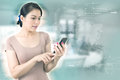 Business concept. Asia Businesswoman touching screen smartphone.