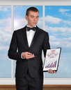 Business concept businessman standing in office and holding clipboard with diagram Royalty Free Stock Photos