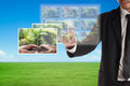 Business concept of csr or corporate social responsibility businessman select a photo on touch screen for plan Royalty Free Stock Image