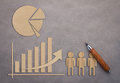 Business concept with graph and pie chart paper cut Royalty Free Stock Photo