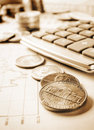 Business concept image sepia tint of calculator and coins on chart Royalty Free Stock Photo