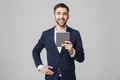 Business Concept - Portrait Handsome Business man playing digital tablet with smiling confident face. White Background. Copy Space Royalty Free Stock Photo